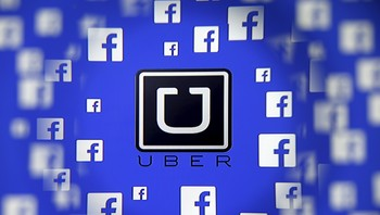 FACEBOOK-UBER/ Logo of the Uber and Facebook are seen through magnifier on display in this illustration taken in Sarajevo