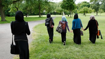 BRITAIN-MUSLIM/VEILS Yasmin, Hana and their friends walk in the park after finishing a GCSE exam near their school in Hackney, east London