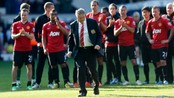 SOCCER-ENGLAND/ Manchester United manager Ferguson walks towards the fans to accept their applause after their English Premier League soccer match against Albion at The Hawthorns in West Bromwich