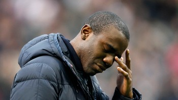 SOCCER-ENGLAND/ Bolton Wanderers' Muamba reacts ahead of their English Premier League soccer match against Tottenham Hotspur at the Reebok Stadium in Bolton