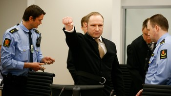 NORWAY-TRIAL/ Defendant Norwegian mass killer Breivik gestures as arrives in courtroom in Oslo
