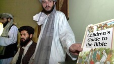 Taliban og International Assistance Mission  (Foto: SAEED KHAN/Afp)
