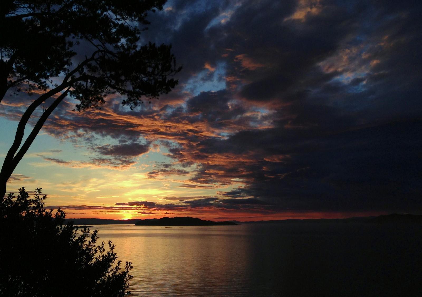 Solnedgangen sett fra Idse i Strand.