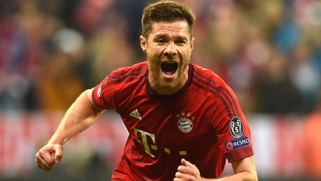 TOPSHOT - Bayern Munich's Spanish midfielder Xabi Alonso celebrates scoring during the UEFA Champions League semi-final, second-leg football match between FC Bayern Munich and Atletico Madrid in Munich, southern Germany, on May 3, 2016. / AFP PHOTO / Christof Stache