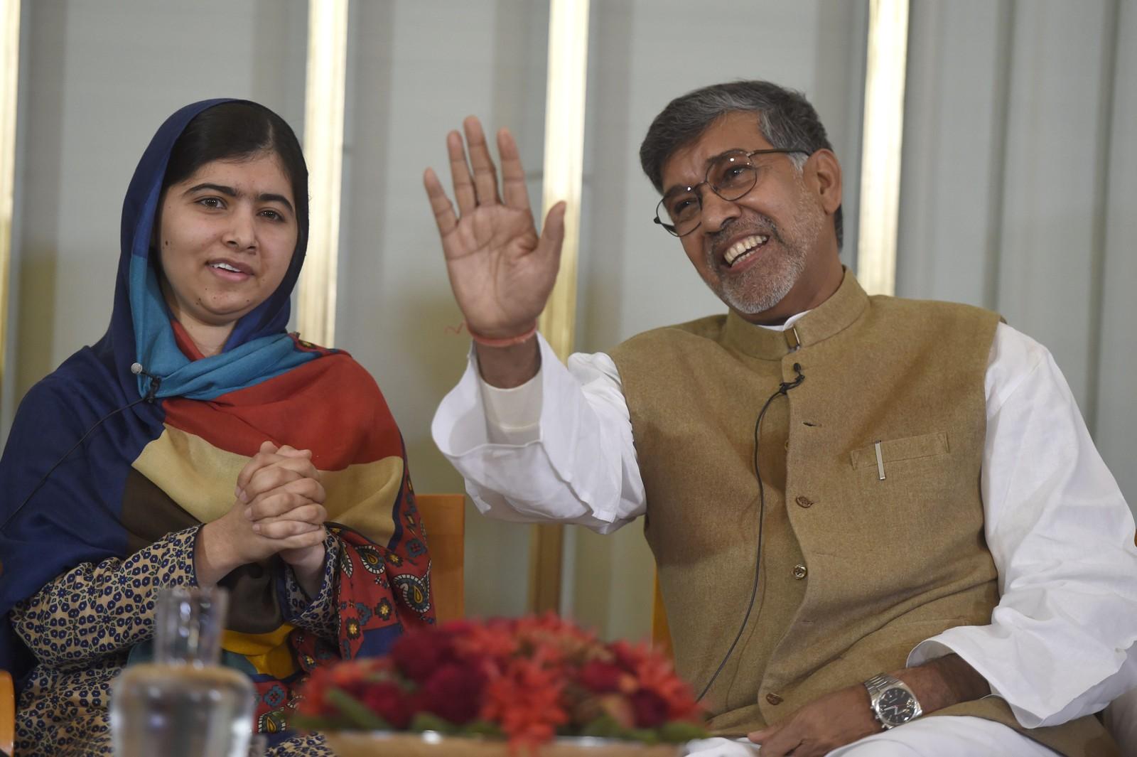 DELER FREDSPRISEN: Menneskerettsforkjemperne Malala Yousafzai (17) fra Pakistan og Kailash Satyarthi (60) fra India er i Oslo for å motta Nobels fredspris for 2014. De får prisen for kampen for barns rett til utdanning og for kampen mot barnearbeid. Bildet fra pressekonferansen i Oslo 9.12.2014.