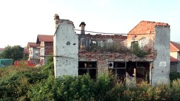 Bygninger med skader etter krigen i Bosnia