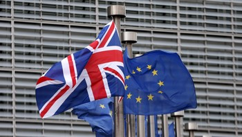BRITAIN-EU/ File photo of a Union Jack flag fluttering next to European Union flags ahead of a visit from Britain's Prime Minister Cameron at the EU Commission headquarters in Brussels