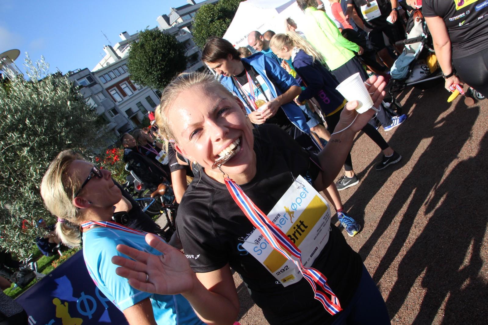 Britt Elin Riseng Berg var klart fornøyd med medaljen.