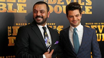 "Latif Yahia and Actor Dominic Cooper pose for photographers at the British Premiere of ""The Devil's Double"", in London"