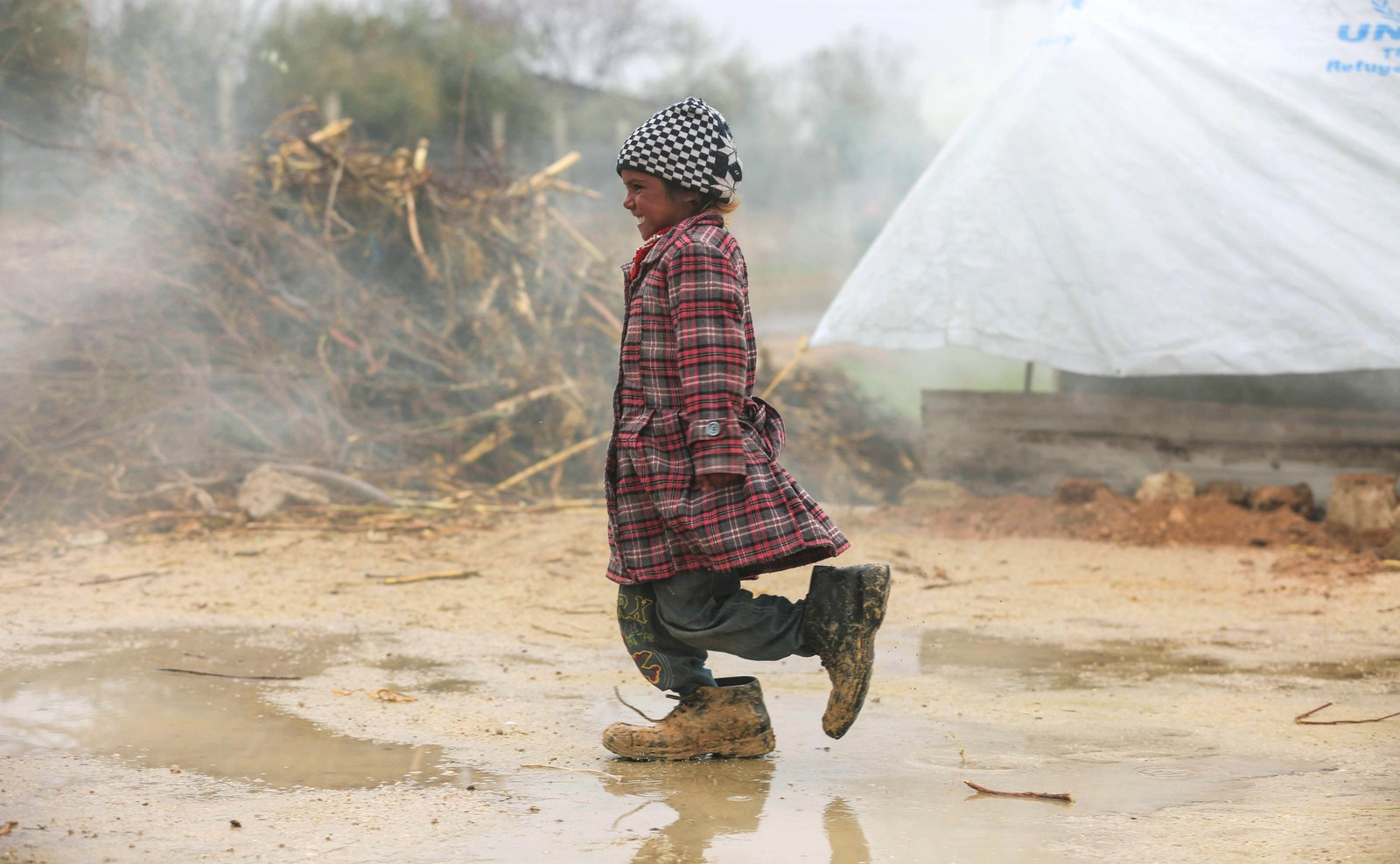 En syriske jente i en flyktningeleir utenfor Damaskus.