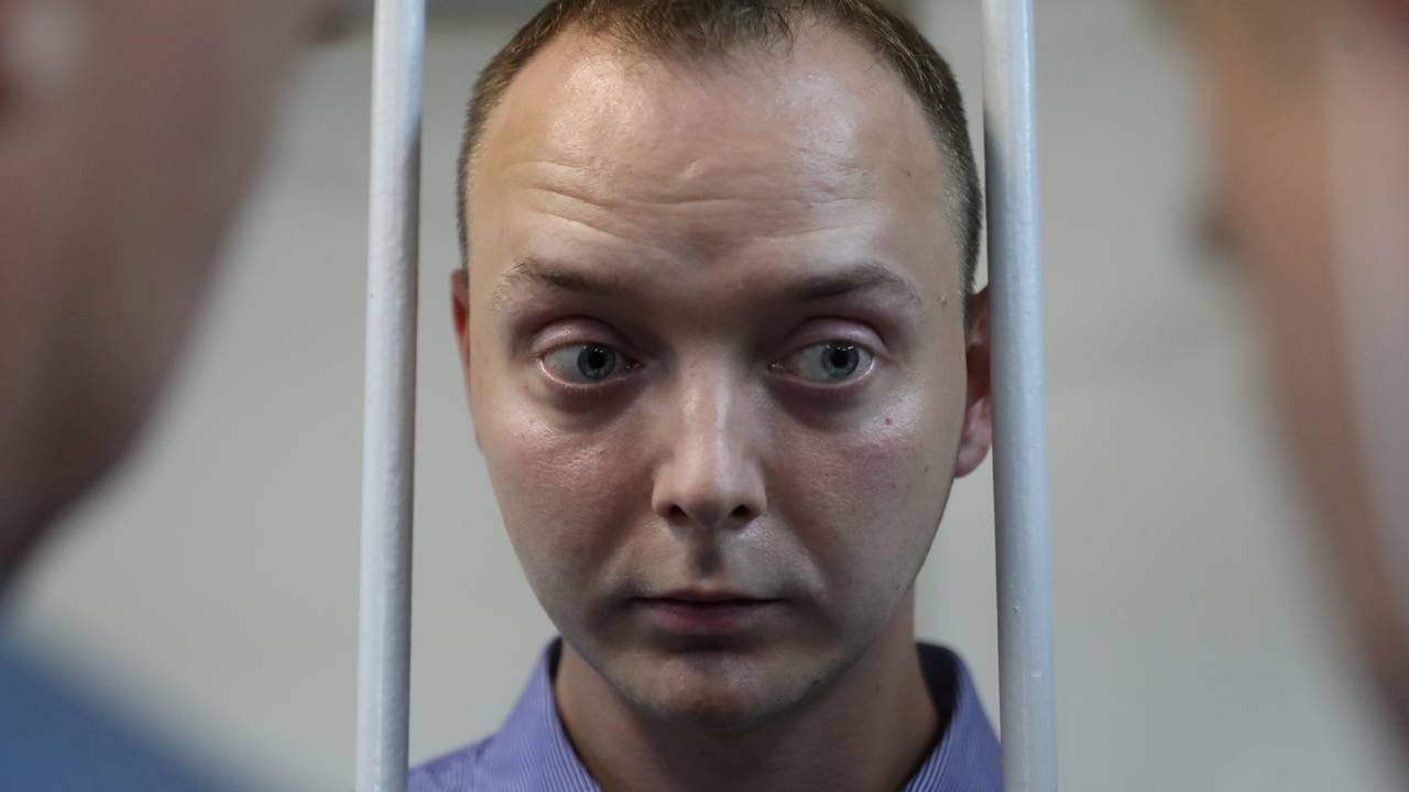 Ivan Safronov, a former journalist who works as an aide to the head of Russia's space agency Roscosmos, detained on suspicion of treason attends a court hearing in Moscow