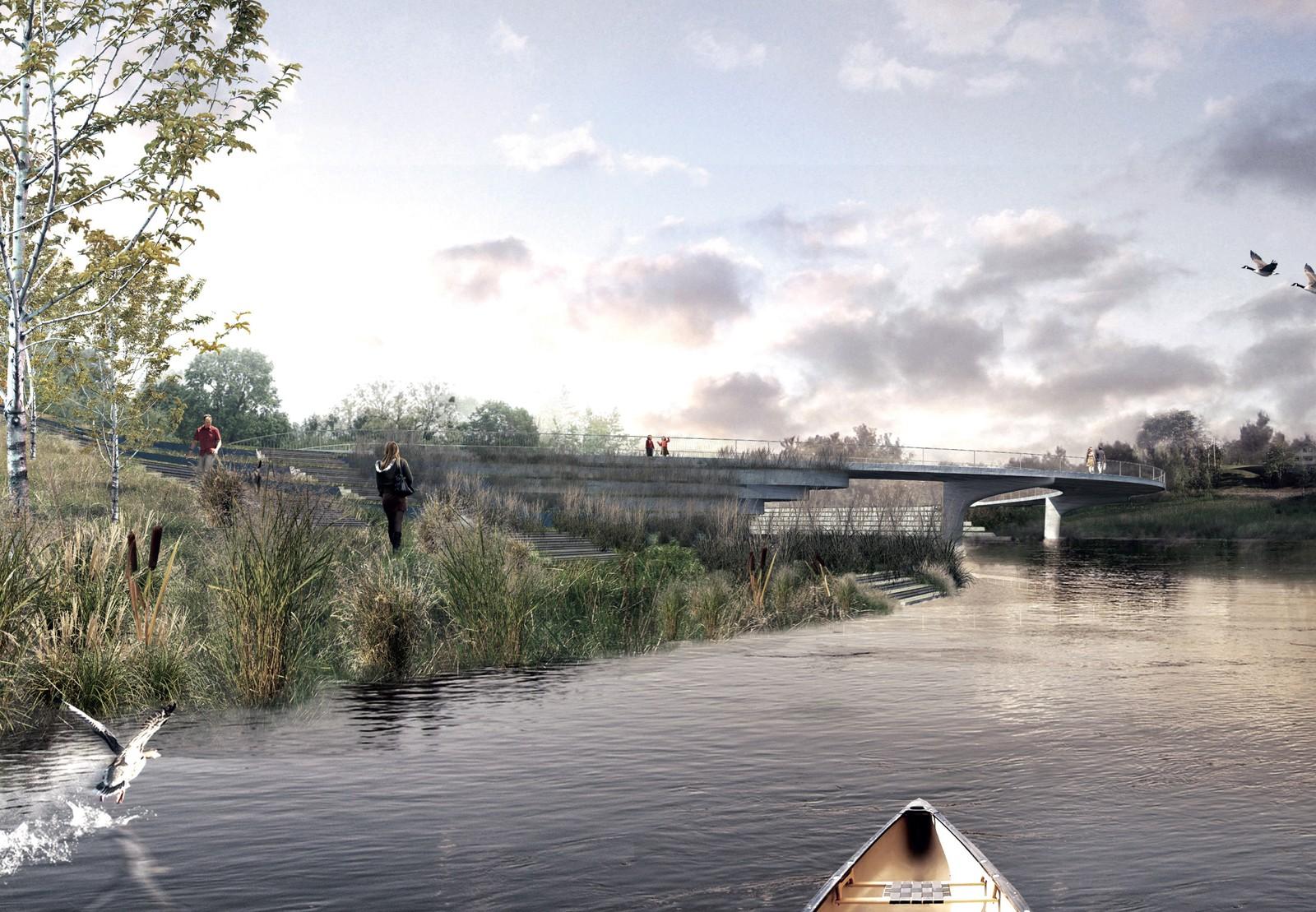 En ny gangbru krysser elva.