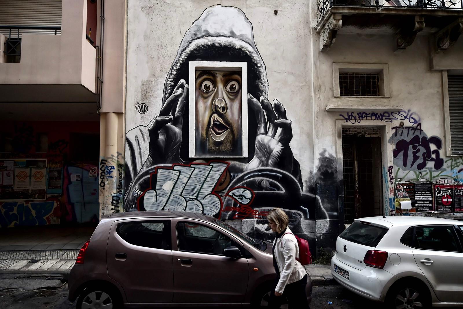 En graffitikunstner kalt WD (Wild Drawing) har laget dette bildet i Athen. Han er fra Bali.