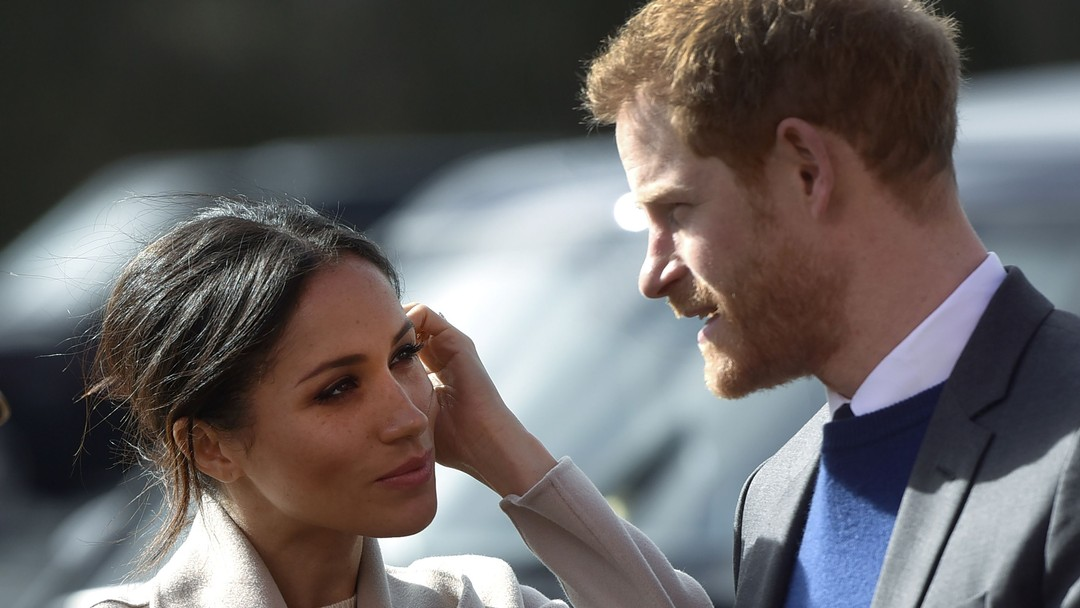 (FILES) In this file photo taken on March 23, 2018 Britain's Prince Harry and US actress and fiancee of Britain's Prince Harry Meghan Markle arrive at the Eikon Centre in Lisburn, to attend an event to mark the second year of youth-led peace-building initiative Amazing the Space.Meghan Markle enters the British royal family in drastically different circumstances from the last American to join: Wallis Simpson, a name that still sends shivers through Buckingham Palace. / AFP PHOTO / Mark MARLOW