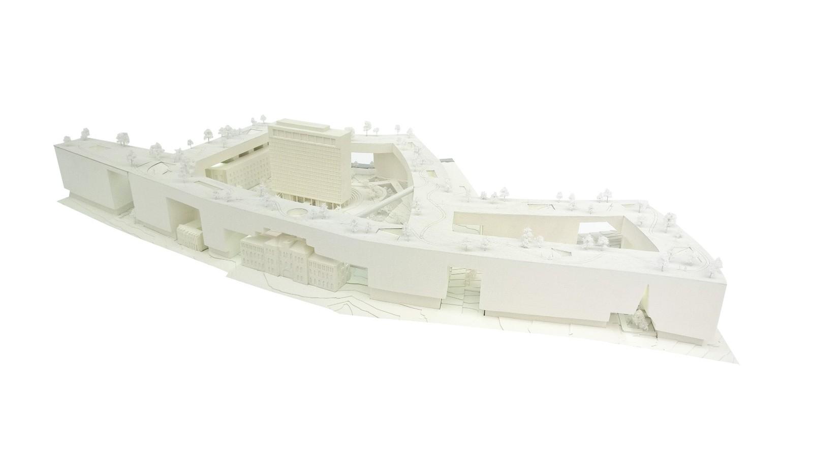 NUMMER 4 - MVRD: Dette forslaget skiller seg fra de andre forslagene ved at det lar bygningsmassen utgjøre en lav mur rundt kvartalet, der ingen bygg ruver høyere enn Høyblokka, og taket på muren er dekket av parkanlegg.