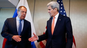 MIDEAST-CRISIS/SYRIA-TALKS U.S. Foreign Secretary Kerry and Russian Foreign Minister Lavrov go for a handshake before their bilateral talks in Munich