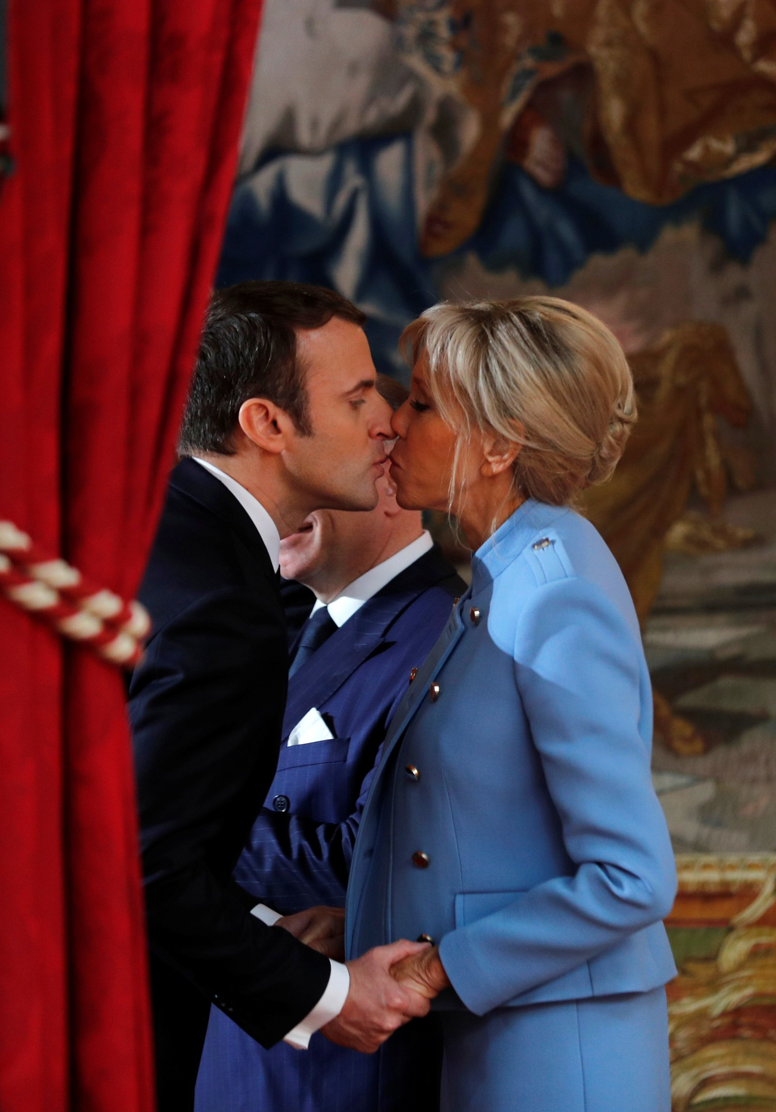 FRANCE-ELECTION/ French President Emmanuel Macron kisses his wife Brigitte Trogneux during the handover ceremony in Paris, France, May 14, 2017. REUTERS/Philippe Wojazer French President Emmanuel Macron kisses his wife Brigitte Trogneux during the handover ceremony in Paris