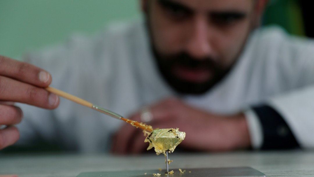 Portuguese chocolatier Daniel Gomes prepares a candy wrapped in pure 23 carat gold during international chocolate fair in Obidos Portugal, March 16, 2018. REUTERS/Rafael Marchante Portuguese chocolatier Daniel Gomes prepares a candy wrapped in pure 23 carat gold during international chocolate fair in Obidos
