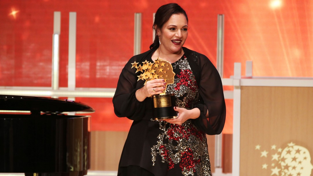 British school teacher Andria Zafirakou reacts after winning the Global Teacher Prize at a ceremony in Dubai, United Arab Emirates, Sunday, March 18, 2018. Zafirakou won the $1 million prize for teaching excellence awarded by the Varkey Foundation. (AP Photo/Jon Gambrell)