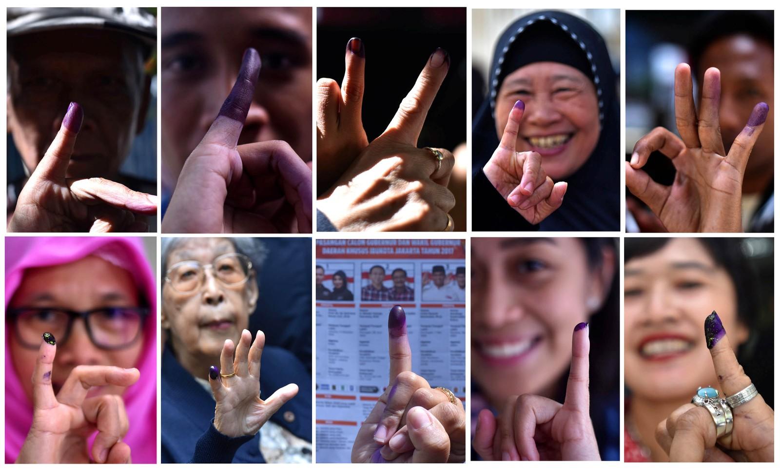 Stemmer med fingeren. Mennesker fikk fingrene farget med blekk da de stemte i Jakarta i Indonesia.