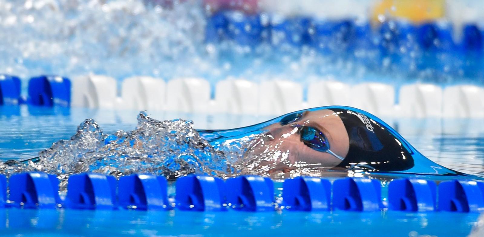 Den amerikanske svømmeren Amy Bilquist gir alt under semifinalen i hundre meter rygg denne uken. Bilquist svømmer for en etterlengtet OL-billett hele denne uka.