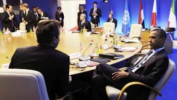 Barack Obama i samtale med David Cameron ved G8-møtet