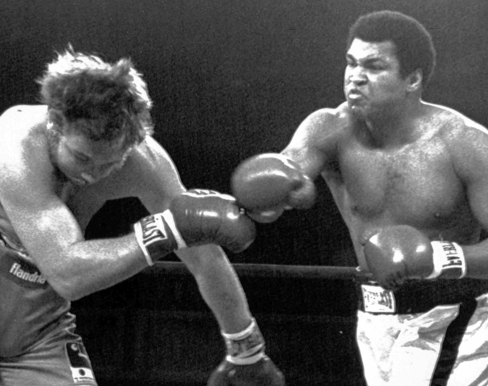 Puerto Rico Ali Coopman American heavyweight boxer Muhammad Ali, right, lands a blow to the jaw of Belgian boxer Jean-Pierre Coopman during their championship fight in San Juan, Puerto Rico, Feb. 21, 1976. (AP Photo)