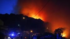 Skogbrann i Biguglia på Korsika - Foto: PASCAL POCHARD-CASABIANCA/AFP