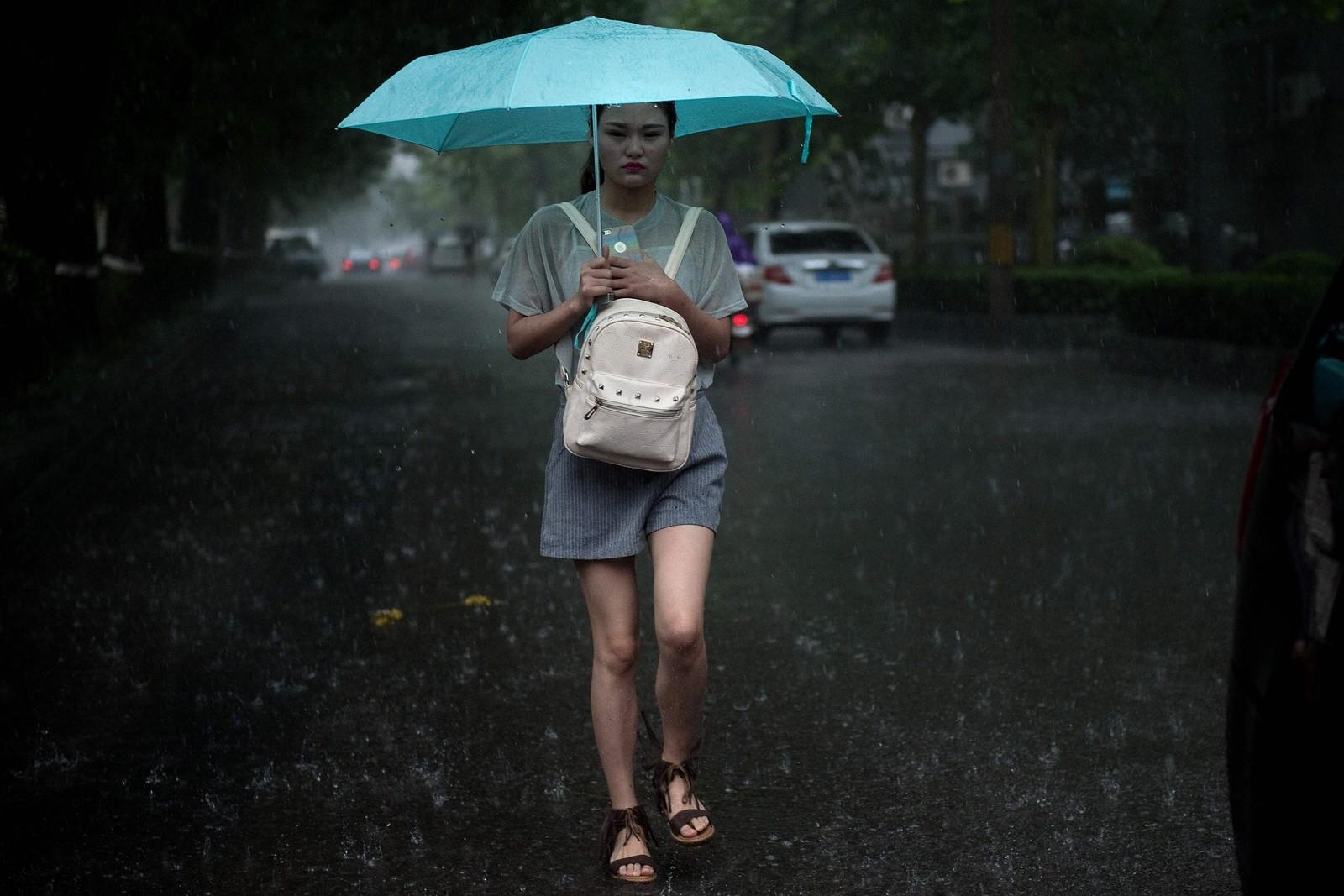 Det er utfordrende å holde seg tørr i den kinesiske hovedstaden Beijing