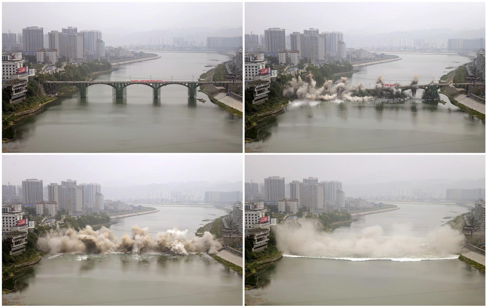 Slik så det ut da den 246 meter lange Lishui-brua gikk i lufta i Zhangjiajie, Kina denne uka. Den 44 år gamle brua skal erstattes av en ny bru på samme sted.