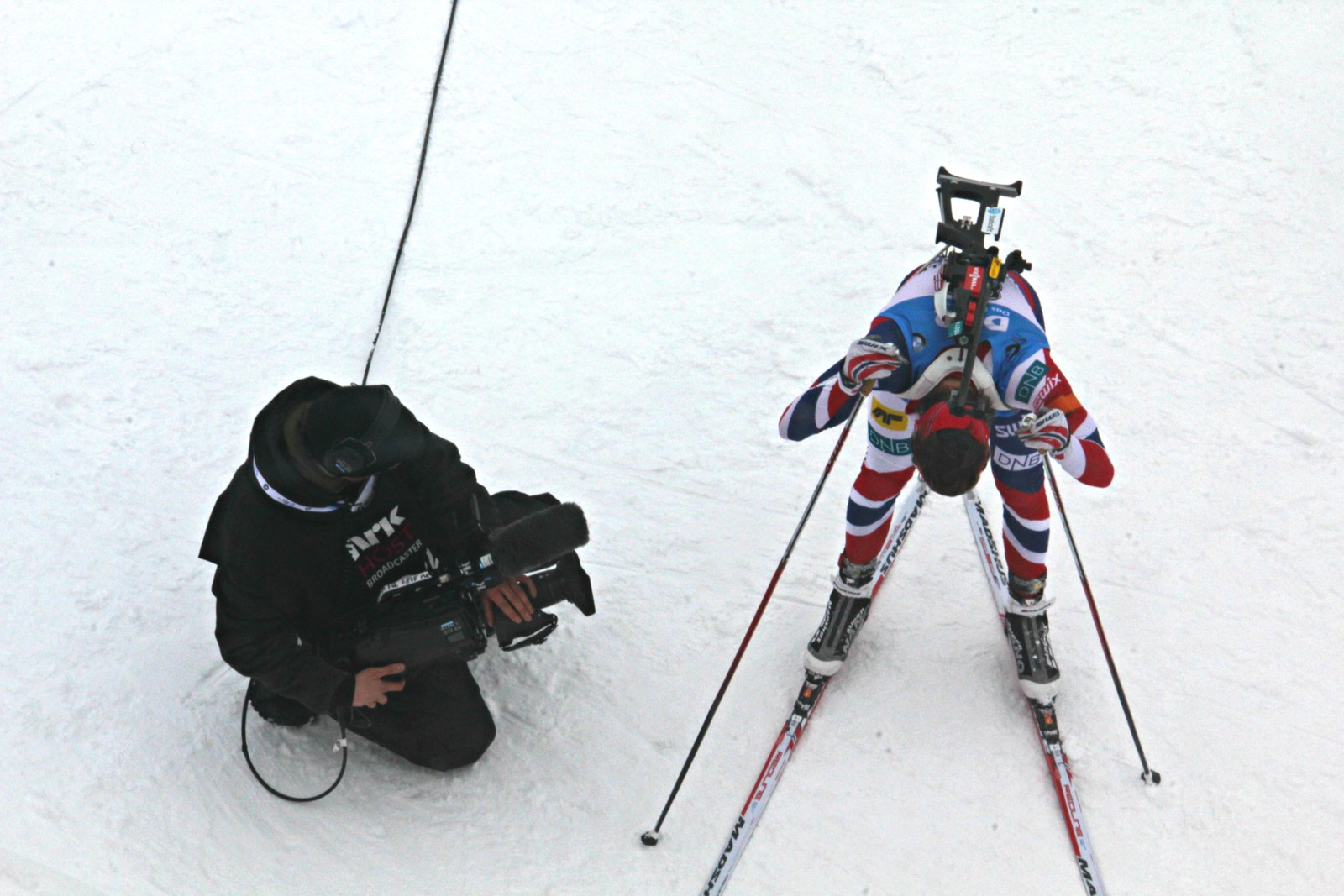 IBU Biathlon World Championships Oslo 2016: Sprint events Saturday 5 March:  Norway's Tiril Eckhoff, winner of the women's sprint event, with Host Broadcaster cameraman in finish area.