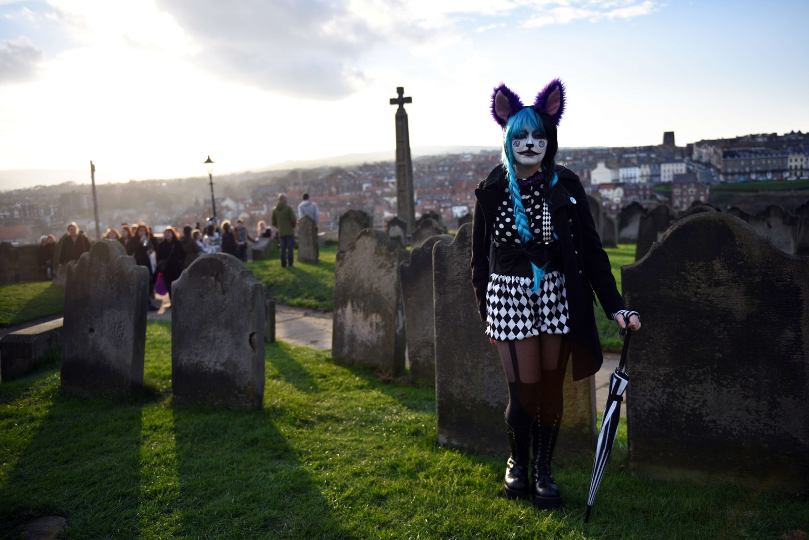 """A woman dressed in a costume is pictured during the biannual """"Whitby Goth Weekend"""" (WGW) festival in Whitby, Northern England, on November 2, 2014. The WGW festival brings thousands of goths and alternative lifestyle fans from the UK and around the world over a weekend of music, dancing and shopping."""