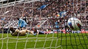 SOCCER-ENGLAND/ Manchester City's Toure scores second goal as Newcastle United's Gutierrez tries to block during English Premier League soccer match in Newcastle