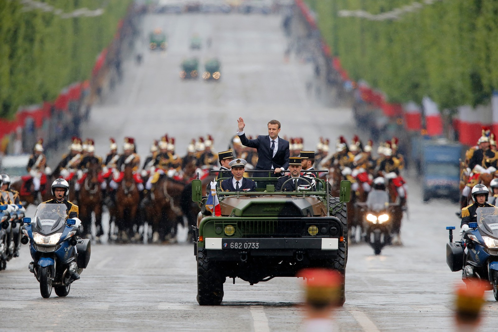 France President Emmanuel Macron New French President Emmanuel Macron waves from a military vehicle as he rides on the Champs Elysees avenue towards the Arc de Triomphe in Paris, France, Sunday, May 14, 2017. (AP Photo/Michel Euler, POOL) Emmanuel Macron