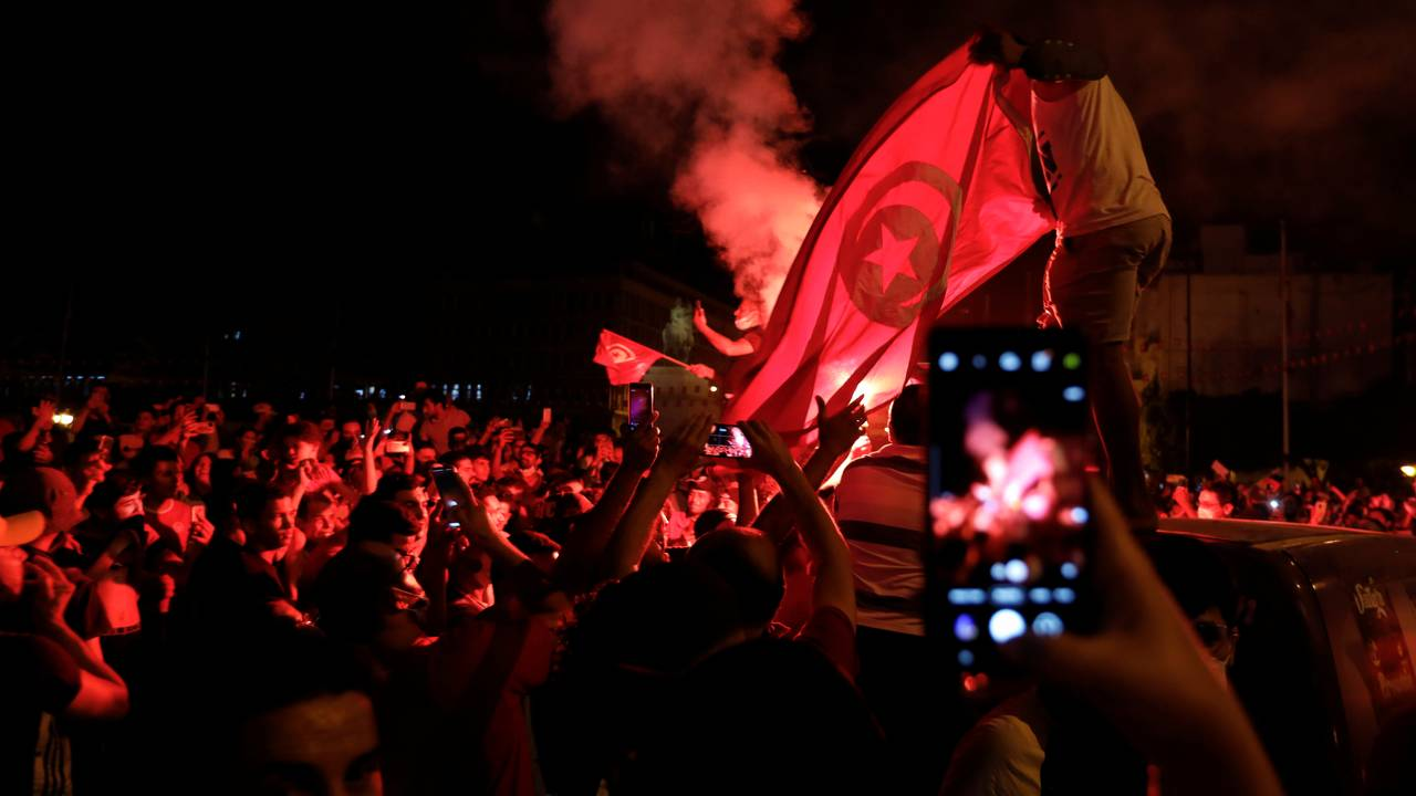 Supporters of Tunisia's President Kais Saied gather on the streets after he dismissed the government and froze parliament, in Tunis