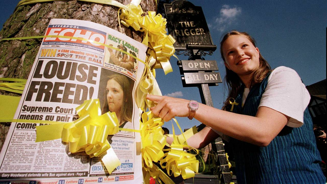 Hayley Nixon, 13, ties a yellow ribbon around a tree outside the Rigger pub in Elton, Cheshire, after villagers heard of the release of British nanny Louise Woodward