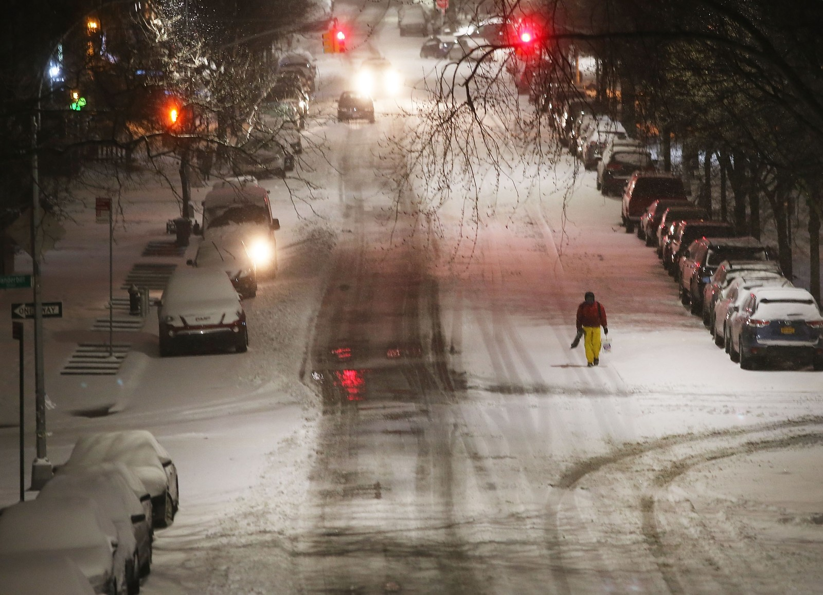 US-MAJOR-BLIZZARD-HAMMERS-EAST-COAST-WITH-HIGH-WINDS-AND-HEAVY-S NEW YORK, NY - MARCH 14: A man walks in the sleet and snow on March 14, 2017 in New York City. New York City and New Jersey are under a state of emergency as a blizzard is expected to bring over one foot of snow and high winds to the area. Schools, flights, businesses and public transportation are closed or restricted throughout the area. Spencer Platt/Getty Images/AFP == FOR NEWSPAPERS, INTERNET, TELCOS & TELEVISION USE ONLY == Major Blizzard Hammers East Coast With High Winds And Heavy Snow