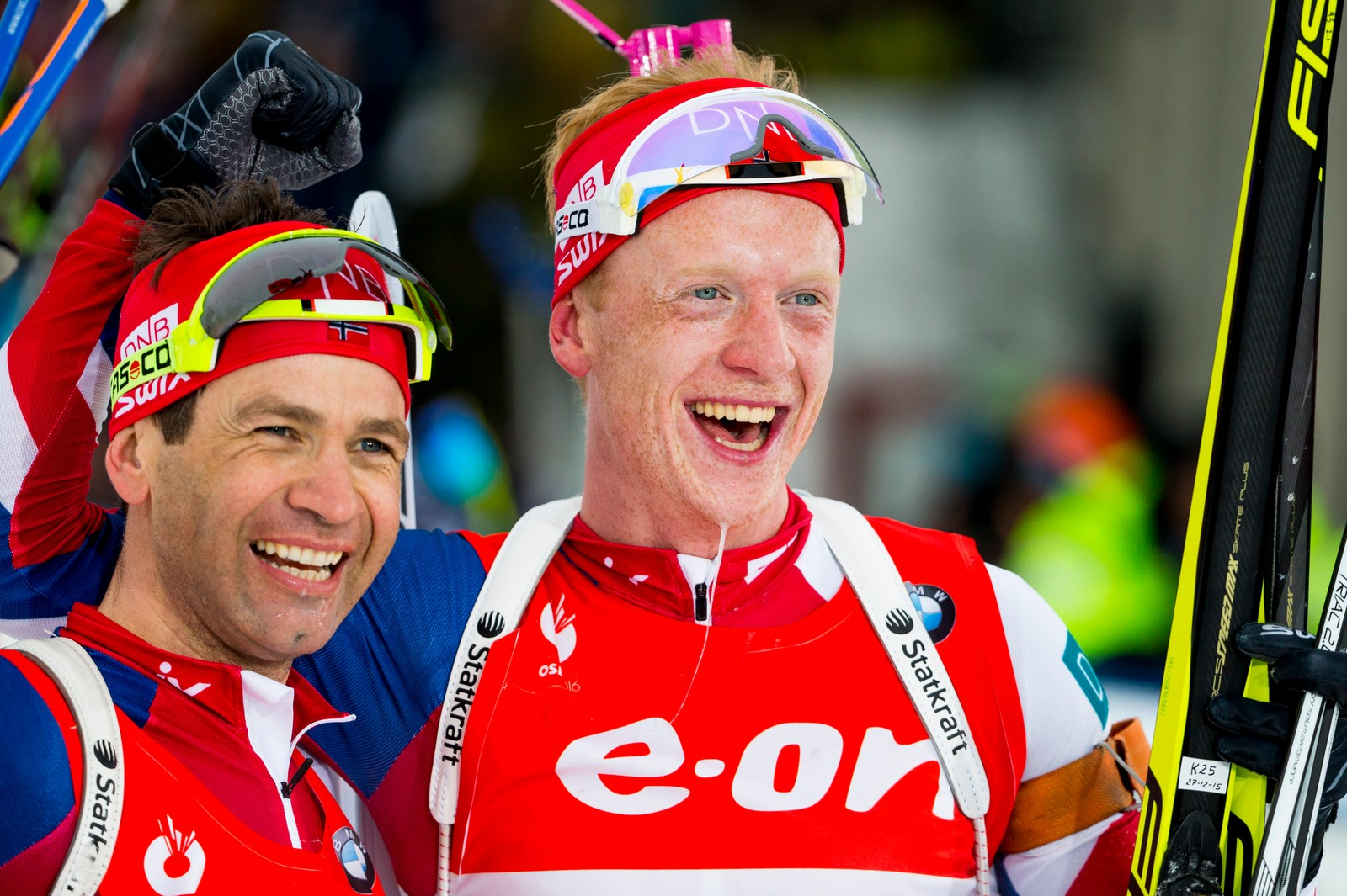 Norway's Johannes Thingnes Bø and Ole Einar Bjørndalen (left) celebrate their gold and bronze medals in the 15 km pursuit event in Holmenkollen 13 March.