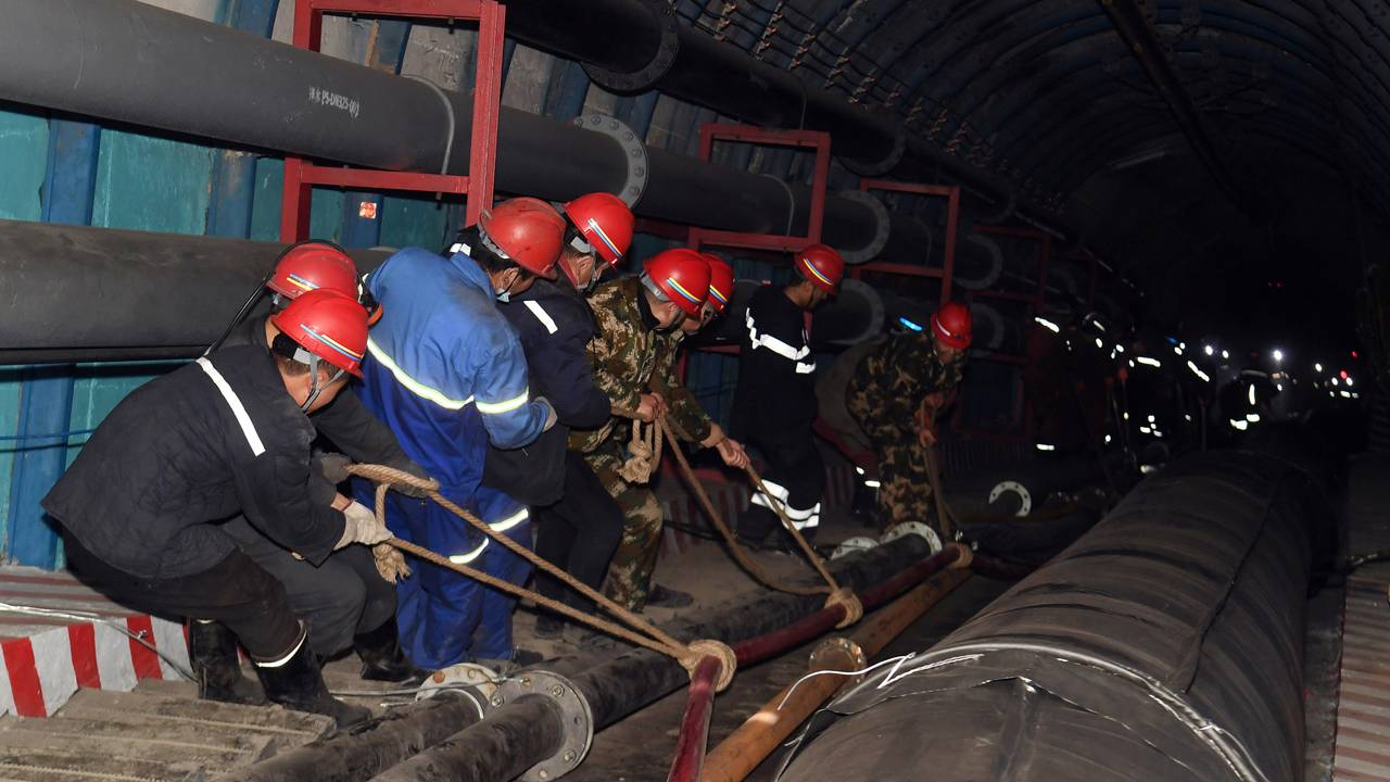 Rescuers work at the site where a coal mine flooded in Hutubi county, Xinjiang